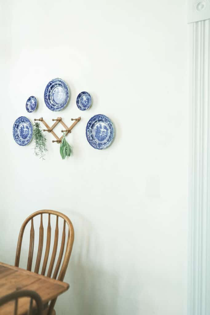 blue and white places hung on a wall with peg shelf
