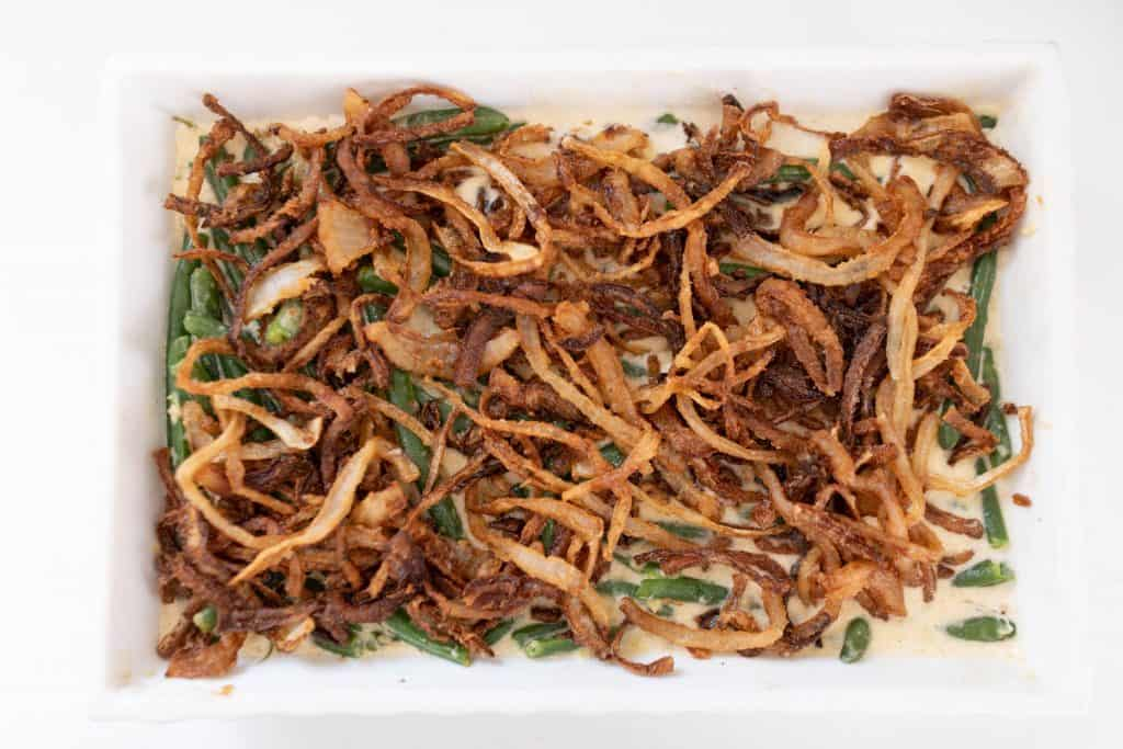 classic green bean casserole from scratch in a white baking dish