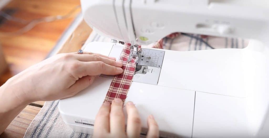 fabric on a sewing machine sewing straps for a reversible apron