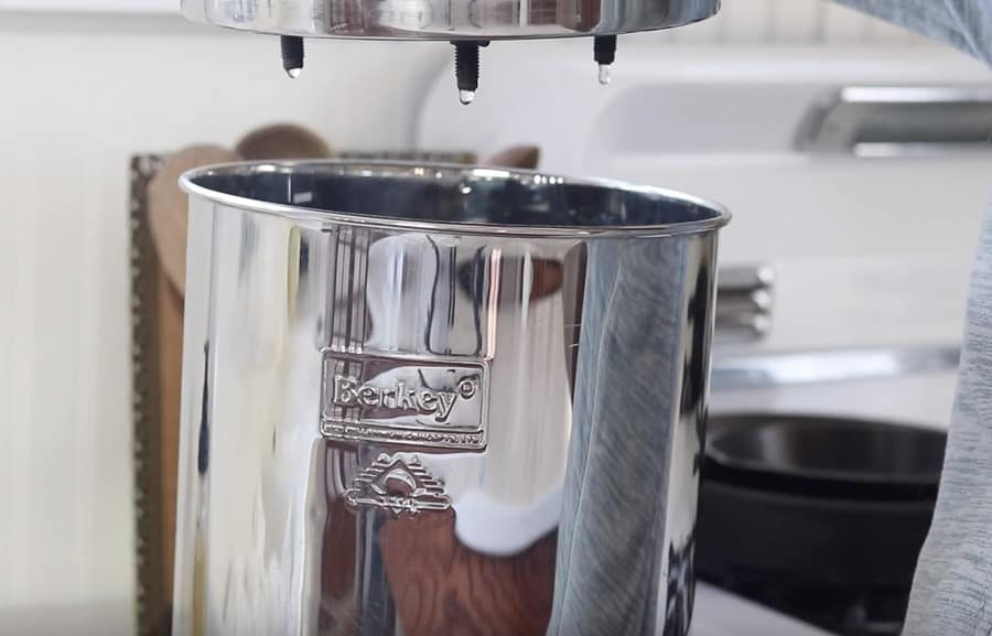 checking Berkey water filter assembly by adding water to the top chamber and see if the water is dripping out of the black filters