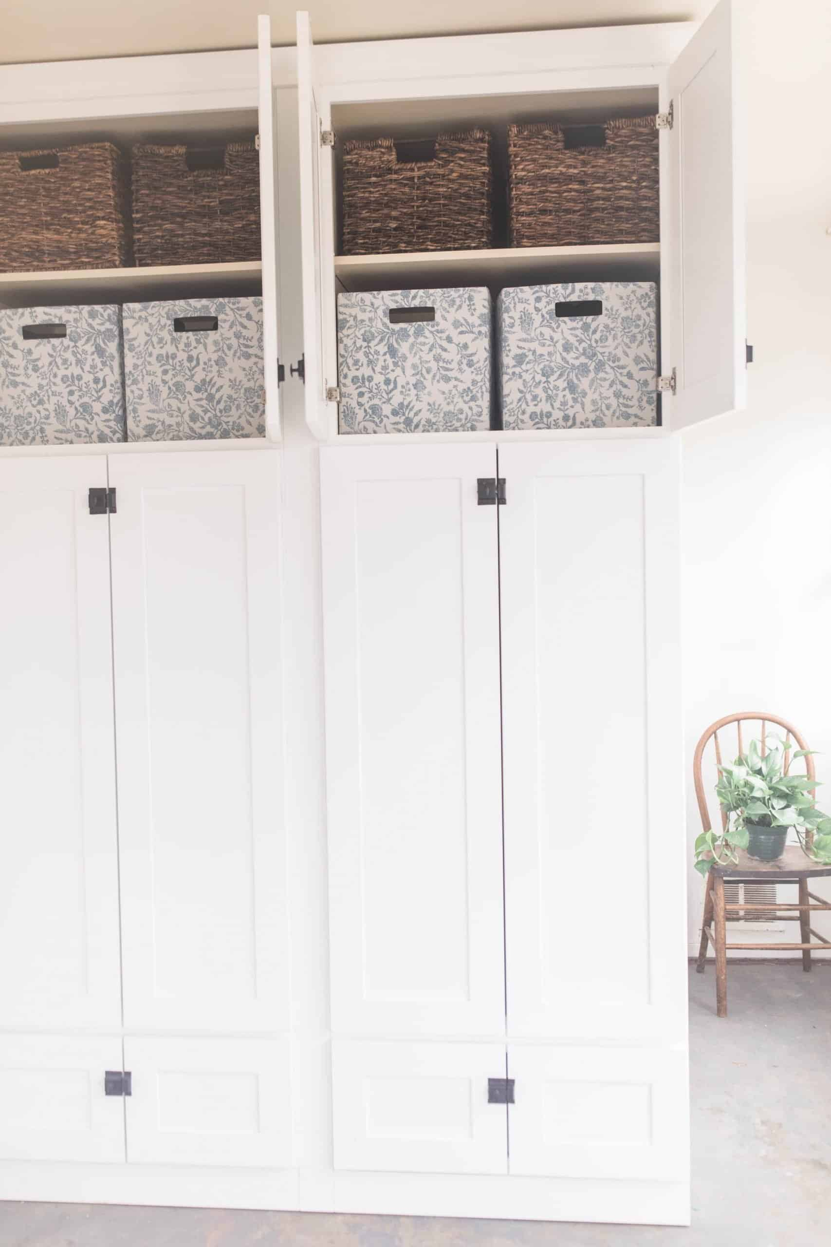 large white cabinet with black latches. Top doors are opening showing can organization