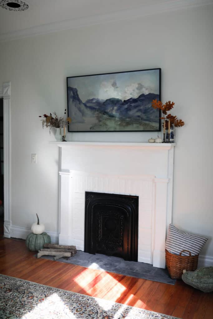 white DIY faux fireplace with white brick and a vintage mantle