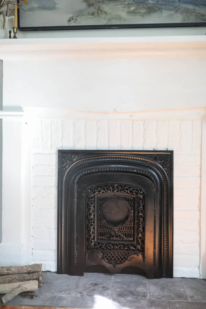 close up of a DIY faux fireplace with mantle