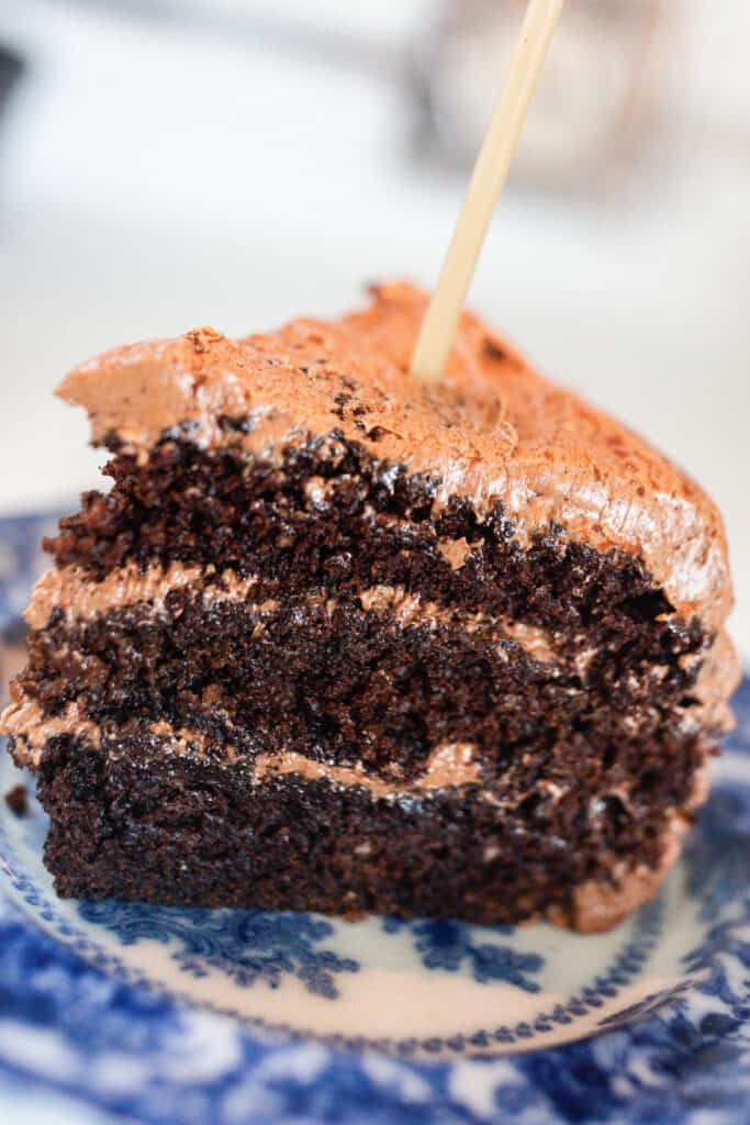 close up picture of a slice of sourdough chocolate cake with chocolate frosting