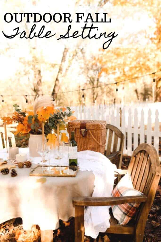 side view of a table with wooden chairs set with a fall tablescape