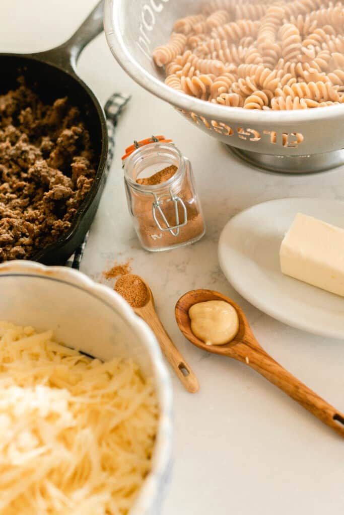 ingredients needed to make healthy hamburger helper on a white quarts countertop