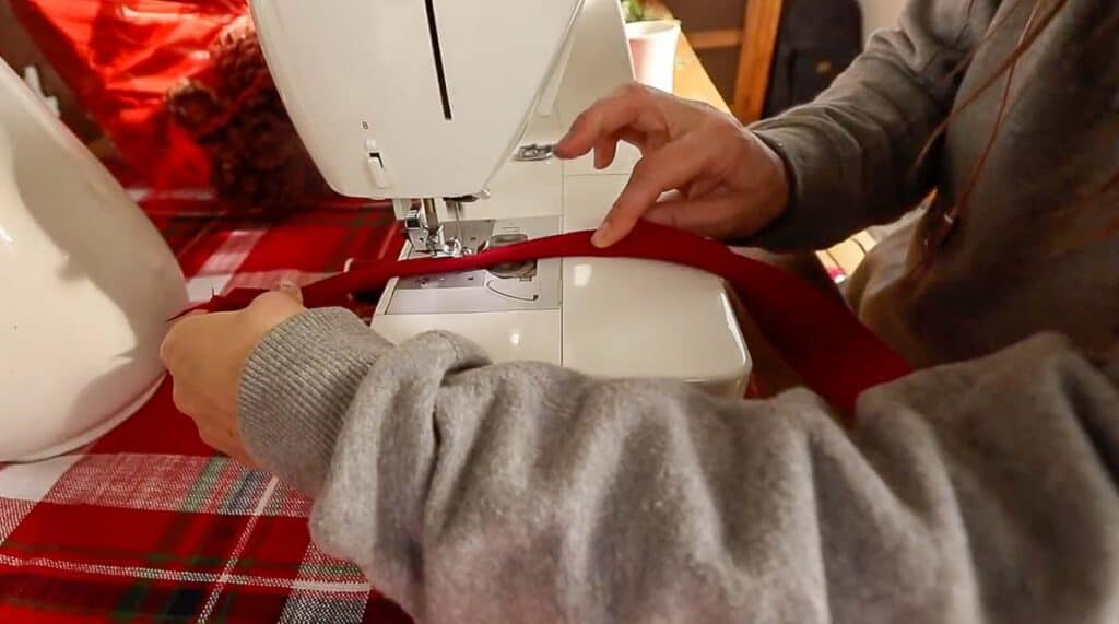 women sewing piping with red fabric and cotton cording