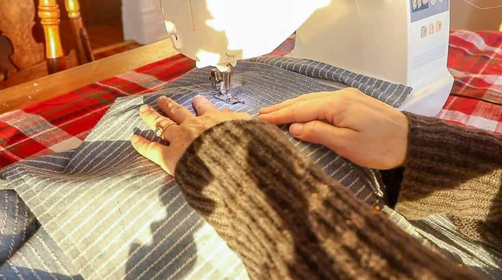 women sewing a pocket onto a half apron with a sewing machine
