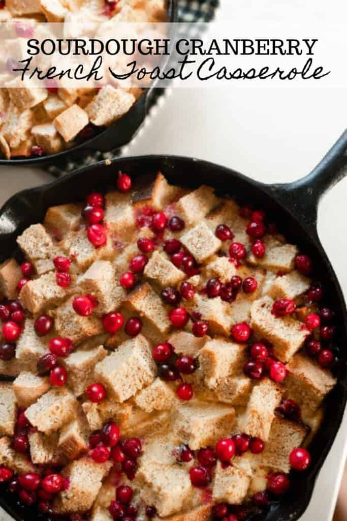 two cast iron skillets with cranberry French toast casserole made with sourdough bread