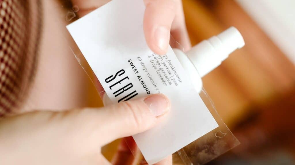applying personalized label to a white pump bottle