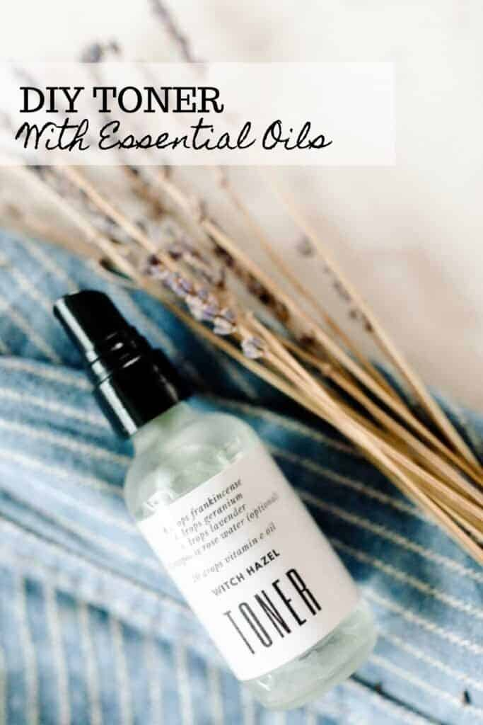 DIY Toner with essential oils in a frosted glass spray bottle on a blue and white stripped towel and dried lavender