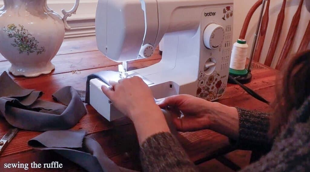 women sewing a ruffle out of flannel fabric on a sewing machine