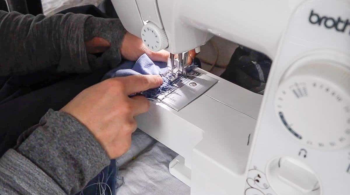 sewing a ruffled onto a blanket
