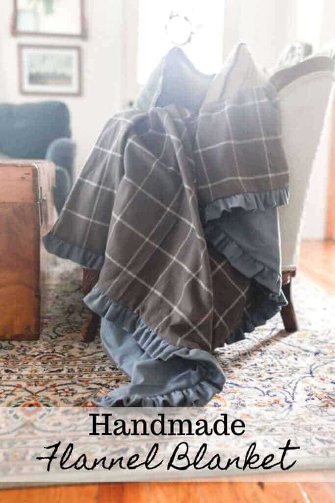 DIy flannel blanket with ruffles draped over a antique couch