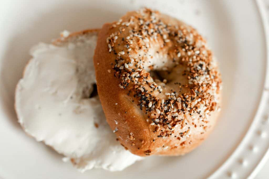 bagel with cream cheese on a white plate