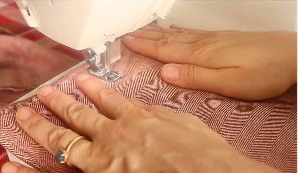 sewing down the center of a pot holder to hold the fabric together