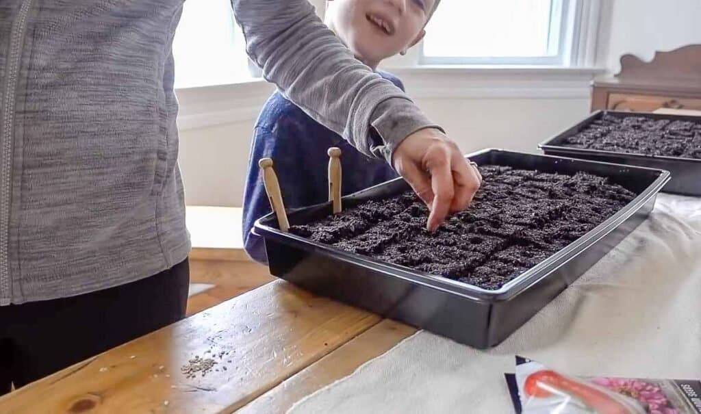 women and son starting seeds for a garden